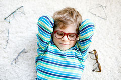 Close-up portrait of little blond kid boy with brown eyeglasses Stock Photography