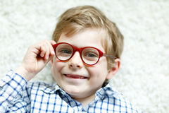 Close-up portrait of little blond kid boy with brown eyeglasses Royalty Free Stock Image