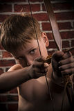 Close up portrait- little boy with bow and arrow Royalty Free Stock Photography