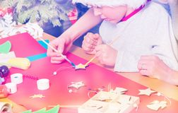 Boy decorates Christmas star together with his mom royalty free stock photo