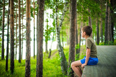 Close up portrait of little boy sitting outdoors Stock Image