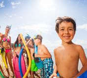 Portrait of a boy with friends on the beach Royalty Free Stock Images