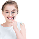 Close-up portrait of  little girl looking through a magnifying. Close-up portrait of cute little girl looking through a magnifying glass - isolated on white Stock Photos