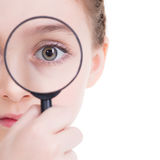 Close-up portrait of  little girl looking through a magnifying g. Close-up portrait of cute little girl looking through a magnifying glass - isolated on white Royalty Free Stock Photo