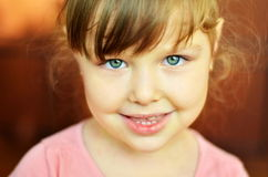 Close-up portrait of a little girl in the room. Beautiful smiling girl Royalty Free Stock Photos
