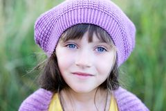 Close-up portrait of little girl in violet beret Royalty Free Stock Photography