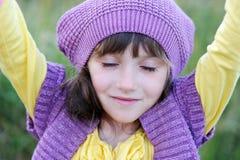Close-up portrait of little girl in violet beret Stock Image