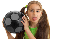 Close-up portrait of a little girl who holds the ball and shows language Royalty Free Stock Photo