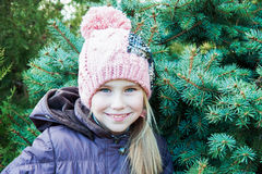 Close up portrait  little girl in winter time near spruce Royalty Free Stock Images