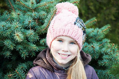 Close up portrait  little girl, winter time  spruce on background Stock Photos