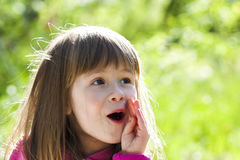 Close-up portrait of a little pretty girl with shouting face exp Royalty Free Stock Photos