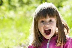 Close-up portrait of a little pretty girl with shouting face exp. Ression Royalty Free Stock Images