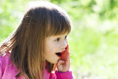 Close-up portrait of a little pretty girl with shouting face exp Stock Images