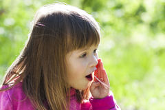 Close-up portrait of a little pretty girl with shouting face exp Royalty Free Stock Photography