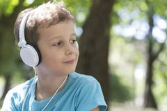 Portrait of a little sweet boy while listening to music stock photography