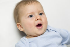 Close up portrait of lovely baby boy with mouth open. Stock Images