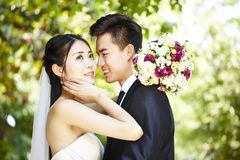 Loving asian newly-wed Stock Photos