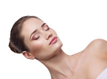 Close-up portrait of a  lying young woman. Close-up portrait of a  lying  beautiful woman on white background Stock Image