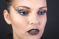 Close-up portrait. Make-up trend, rock black lips Stock Photography