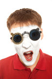 Close-up portrait of a male evil mime with mechanical steampunk. Glasses. Isolated over white royalty free stock photography
