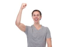 Close up portrait of a man with arm raised up in celebration Stock Photo