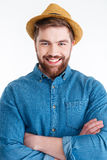 Close-up portrait of man with crossed hands wearing hat stock images
