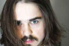 Close-up portrait of man with flowing hair Royalty Free Stock Photography