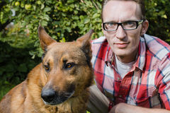 Close up portrait man and his dog Stock Photography