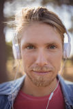 Close up portrait of man listening music on headphone Stock Images