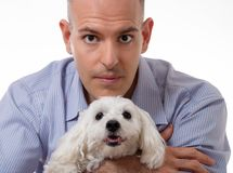 Close up portrait of man and maltese dog in studio,isolated. Close up portrait of man holding a maltese dog in studio, isolated on white background Stock Images
