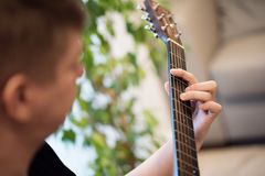 Close-up portrait of a man playing acoustic guitar royalty free stock image