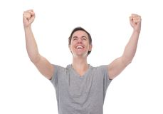 Close up portrait of a man smiling and celebrating with arms outstretched. On isolated white background Royalty Free Stock Image