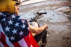 Close up portrait of man wearing helmet and american flag Royalty Free Stock Photo