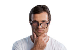 Close up portrait of mature man with hand on chin Royalty Free Stock Photography