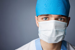 Close up portrait of medical doctor in mask. With copy space Royalty Free Stock Photos