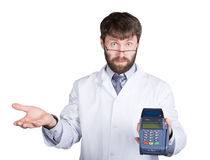 Close-up portrait of a medical doctor, he proposes to pay for treatment in pos-terminal. concept of high cost of the Royalty Free Stock Image
