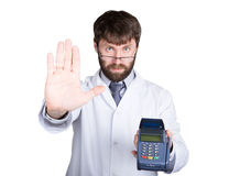 Close-up portrait of a medical doctor, he proposes to pay for treatment in pos-terminal. concept of high cost of the Royalty Free Stock Photography