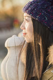 Close-up portrait of a miss traveler. A miss traveler in coat is enjoying the sightseeing of the ancient Houhai lake by stone handrail with bright eyes near royalty free stock image