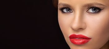 Close-up portrait of model on a dark background royalty free stock photography