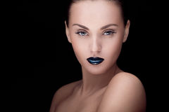 Close up portrait of model with stylish makeup, over black. Close up portrait of young caucasian brunette with dark makeup Royalty Free Stock Image