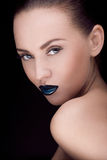 Close up portrait of model with stylish makeup, over black. Close up portrait of young caucasian brunette with dark makeup Stock Photography