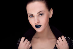 Close up portrait of model with stylish makeup, over black Royalty Free Stock Photos