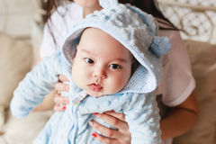 Close-up portrait of 2 month old newborn mixed race Asian Caucasian boy. Natural indoor lighting. Cool tones Stock Photography