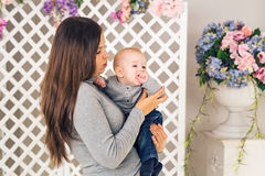 Close-up portrait of mother and baby boy son indoors stock photo