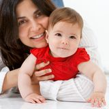Close up Portrait of mother and baby girl. Stock Image