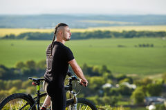 Close-up portrait of the mountain biker looking at beautiful landscape. Royalty Free Stock Images