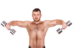Close-up portrait of Muscular guy doing exercises with dumbbells over white background Royalty Free Stock Images