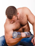 Close-up portrait of Muscular guy doing exercises with dumbbells over white background Stock Photo