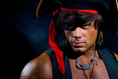 Close-up portrait muscular pirate in the studio on a dark backgr Stock Images