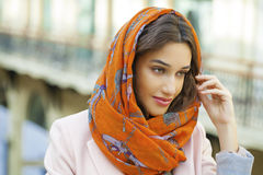 Close up portrait of a muslim young woman wearing a head scarf Stock Photography